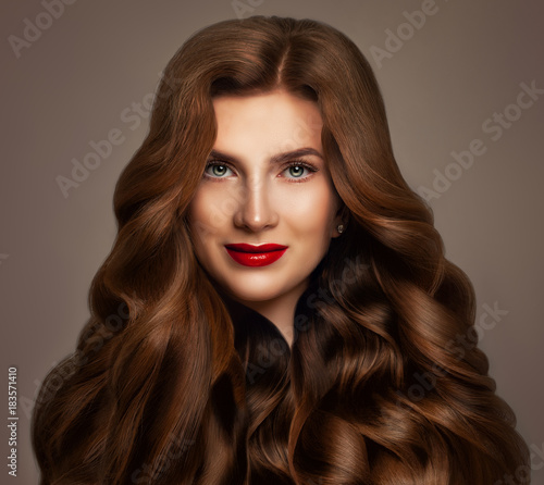 Redhead Woman Fashion Model with Long Red Wavy Hair. Perfect Hairstyle, Haircare Concept