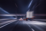 truck moves on highway at night