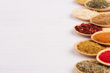 Assortment colorful powdered spices in bamboo spoons, copy space, closeup. - 183585283