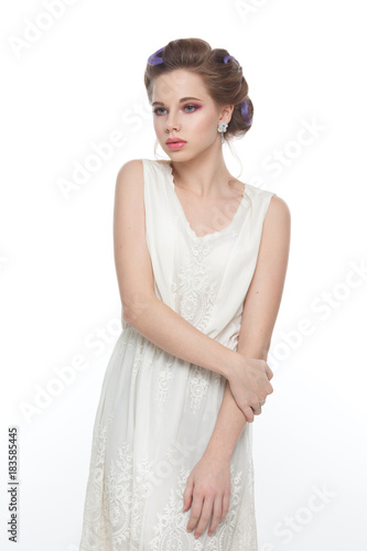 Beauty portrait of a young cute girl with a wedding hairstyle isolated on a white background. © ksi