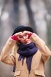 Cute smiley girl holding a heart - shape.