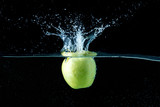 falling apple in water with spray on  black background - 183587074