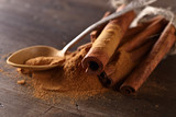 cinnamon sticks and powder on a wooden table - 183588022