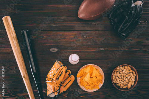 Foto op Aluminium Bol top view of various snacks and sports equipment on wooden table