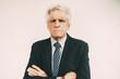 Portrait of displeased senior businessman in suit