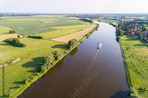 Foto Murales Schiff fährt auf Fluss, Deutschland