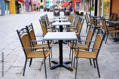 Fototapeta Street cafe at sunny morning in Venice