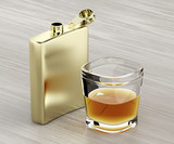 Hip flask and a glass of whiskey - 183606282