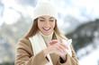 Leinwandbild Motiv Woman applying moisturizer cream to hydrate hands