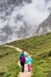 Quadro tourist girls at the Dolomites