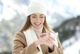 Woman applying moisturizer cream to hydrate hands - 183617409