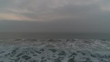 Aerial view over sea waves, foggy sunrise - 183619623