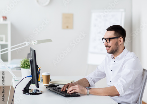 Wall mural businessman typing on computer keyboard at office