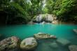 Breathtaking green waterfall at deep forest, Erawan waterfall located Kanchanaburi Province, Thailand - 183624007