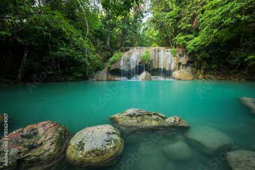 Breathtaking green waterfall at deep forest, Erawan waterfall located Kanchanaburi Province, Thailand - 183624007