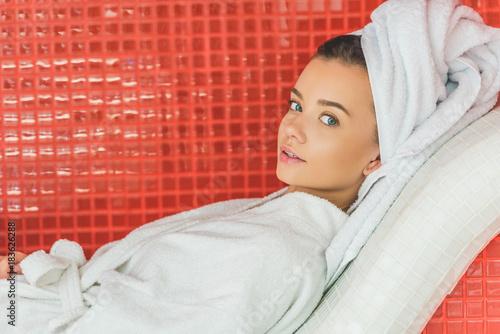 beautiful young woman in bathrobe relaxing at spa salon