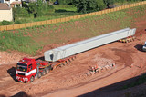truck transporting a concrete beam - 183626498