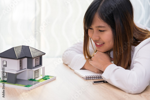 Plakát Smile woman looking at home and getting ready to sign contract for investment - satisfy in home