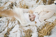 Portrait of a girl lying on snow covered dry grass 9160.