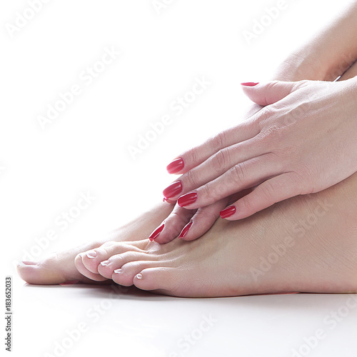 Tuinposter Pedicure Hands and feet of girl model. Health care concept. White background