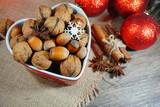 Nuts and spices.Christmas time. At the holiday table.Still life, food and drink, seasonal and holidays concept   - 183654696