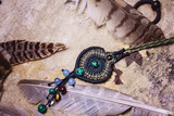 Natural gemstone handmade macrame meterial necklace with wild feather background