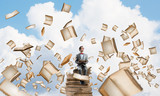 Young businessman or student studying the science and books fly around - 183658663
