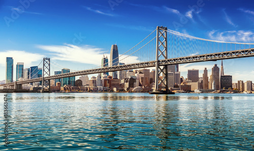 Wall mural Downtown San Francisco and Oakland Bay Bridge on sunny day