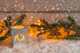 Little lantern in the snow with Christmas decoration and fir branch - 183664676