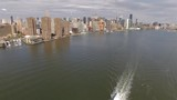 Aerial real time shot of Downtown, Manhattan. Camera is approaching to Downtown Manhattan from East River. - 183671002