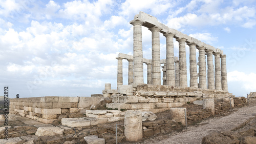 Temple of Poseidon and sky with clouds
