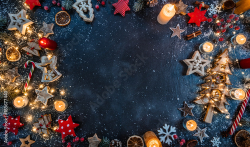 Christmas background with wooden decorations and candles. Free space for text. - 183677440