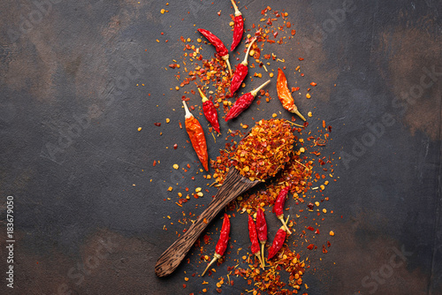 Plexiglas Hot chili peppers Red hot chili peppers on rusty background
