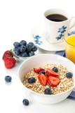 Bowl of Oats with Berry Toppings, Cup of Blueberries, and Cup of - 183686278