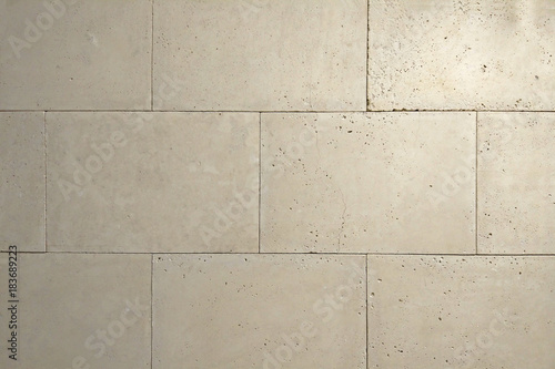 Poster Betonbehang wall of ground stone slabs, backround texture