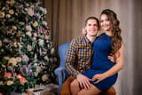 Beautiful young couple in the New Year's atmosphere, photo session in the studio - 183689480