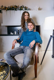Beautiful young couple in the New Year's atmosphere, photo session in the studio - 183691401