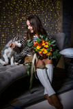 Beautiful girl in a Christmas atmosphere with puppies Husky - 183691652