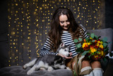 Beautiful girl in a Christmas atmosphere with puppies Husky - 183691675