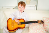 boy is playing guitar