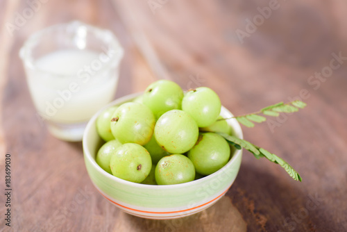 Indian gooseberry fruit and juice on wooden background,healthy food