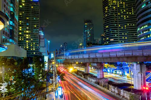 Papiers peints Bangkok The beautiful landscape of Bangkok at night, full of light and busy traffic. long exposure