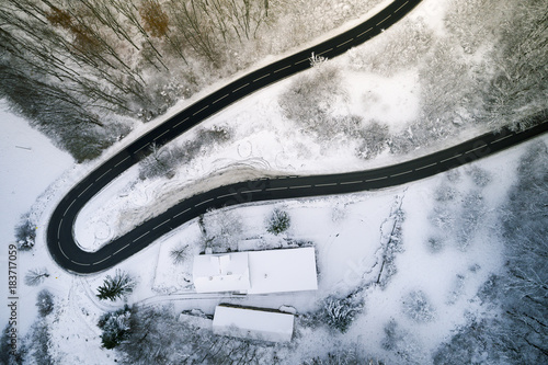 Fototapeta Aerial view of a mountain road in winter in Austria taken with a copter, drone