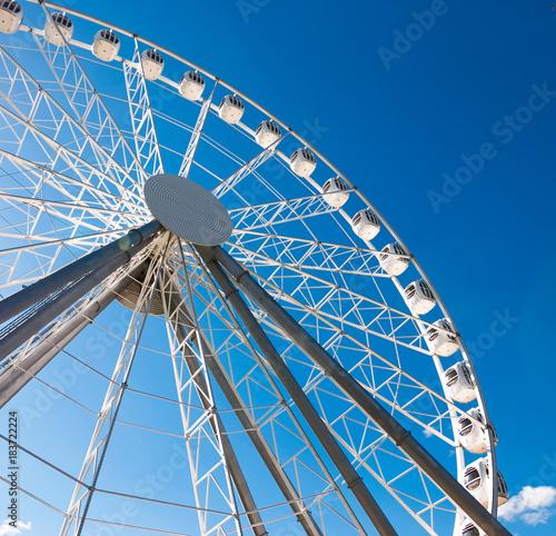 Foto op Aluminium Amusementspark Amusement park and entertainment. Ferris wheel and slides.