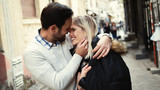 Romantic young happy couple kissing and hugging - 183723436
