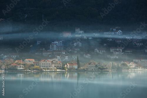 Deurstickers Ochtendgloren View of the city on the Adriatic sea coast in Montenegro. Misty landscape