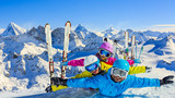 Happy family enjoying winter vacations in mountains . Ski, Sun, Snow and fun. - 183728638