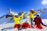 Happy family enjoying winter vacations in mountains . Ski, Sun, Snow and fun. - 183729078
