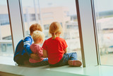 kids waiting for plane in airport - 183736852