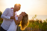 Lovely couple dancing outside in sunset - 183749828